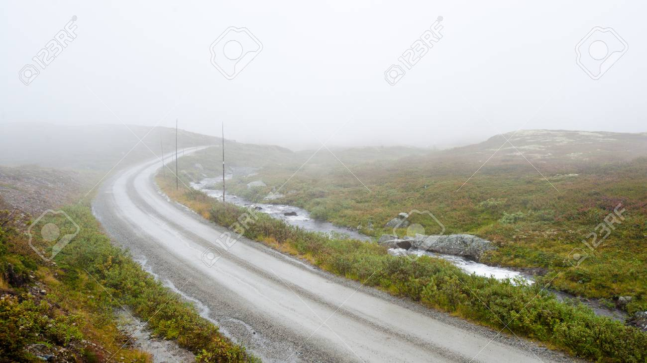 A country road over foggy mountain in Norway Stock Photo - 10445693
