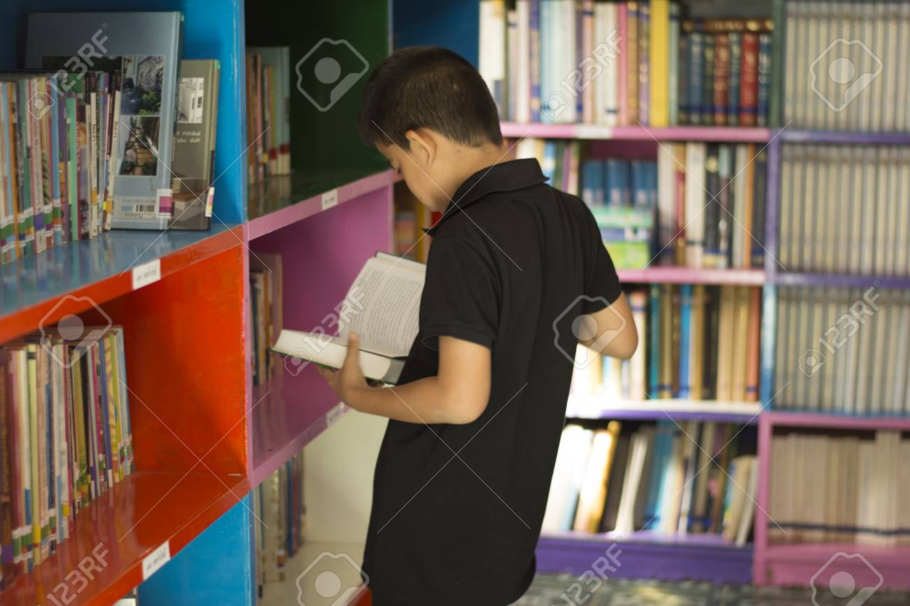 The Boy In Black Read Books Front Of A Bookshelf Library