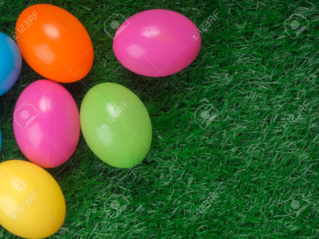 Plastic Easter Eggs On Grass Top View Stock Photo