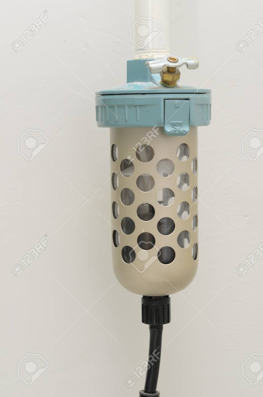 An old and rust industrial air filter Stock Photo - 16415195