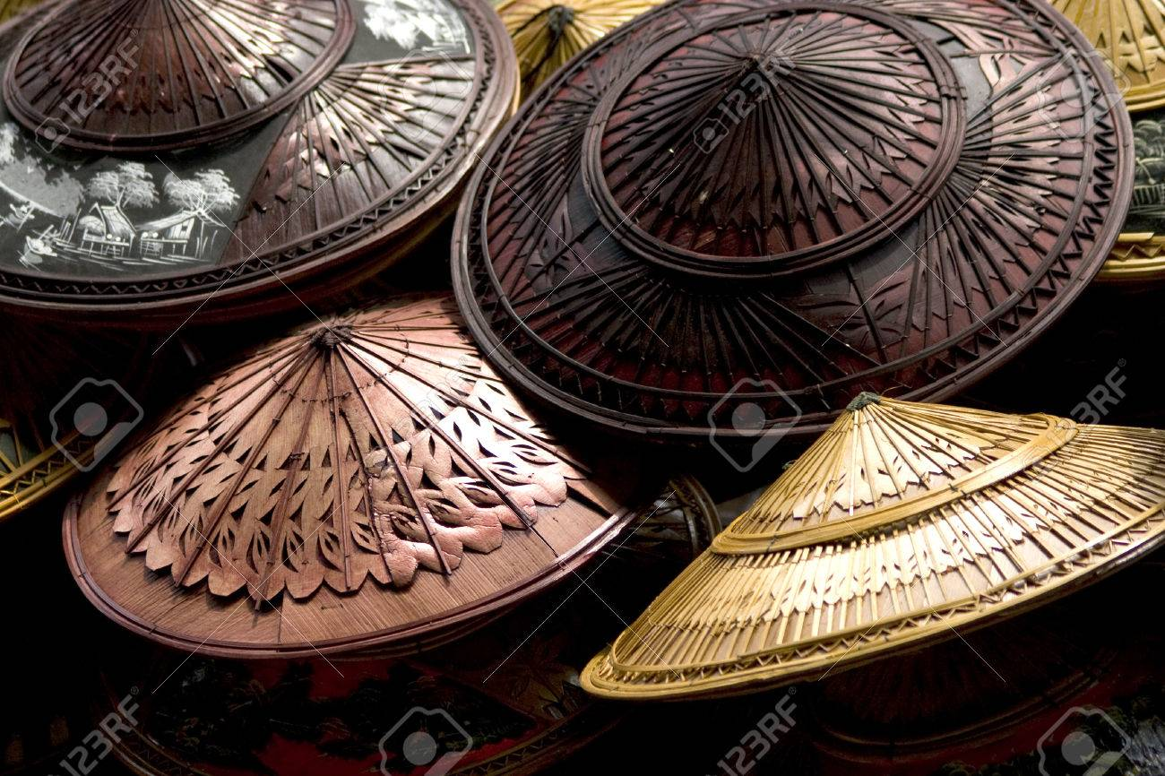 a hat made of bamboo and palm leaves shaped like an inverted basin - 22830926