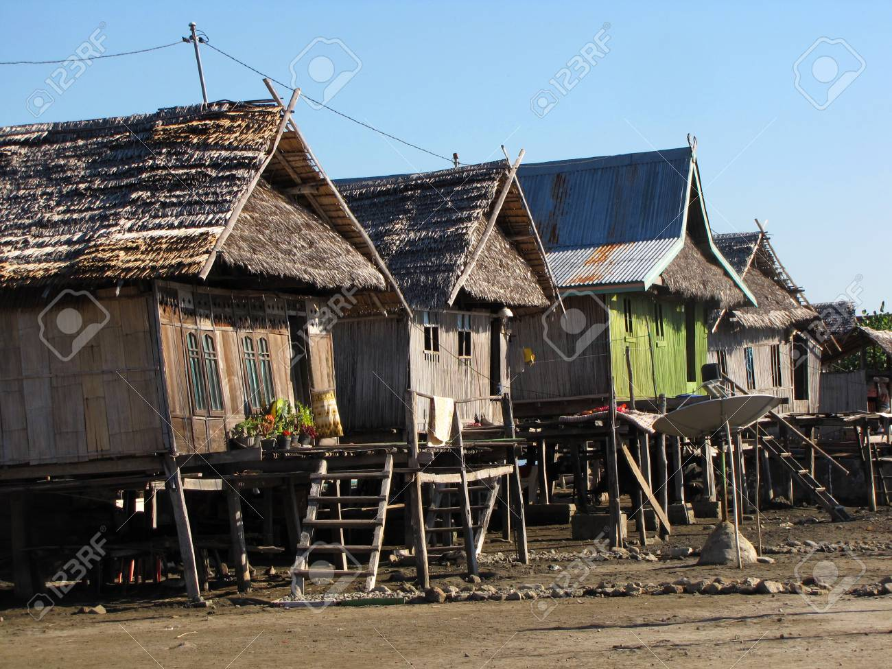 Wooden Houses On The Poles In A Little Fishing Village On The