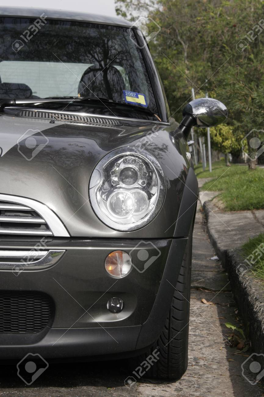 Front Of A Grey Metallic Small Car On A Street Stock Photo - 1518000