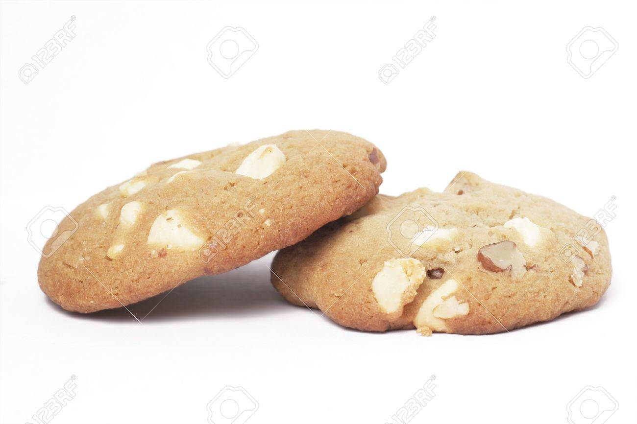 Two Cookie Biscuit With White Chocolate And Macadamia Nuts, Plain Background Stock Photo - 2921148