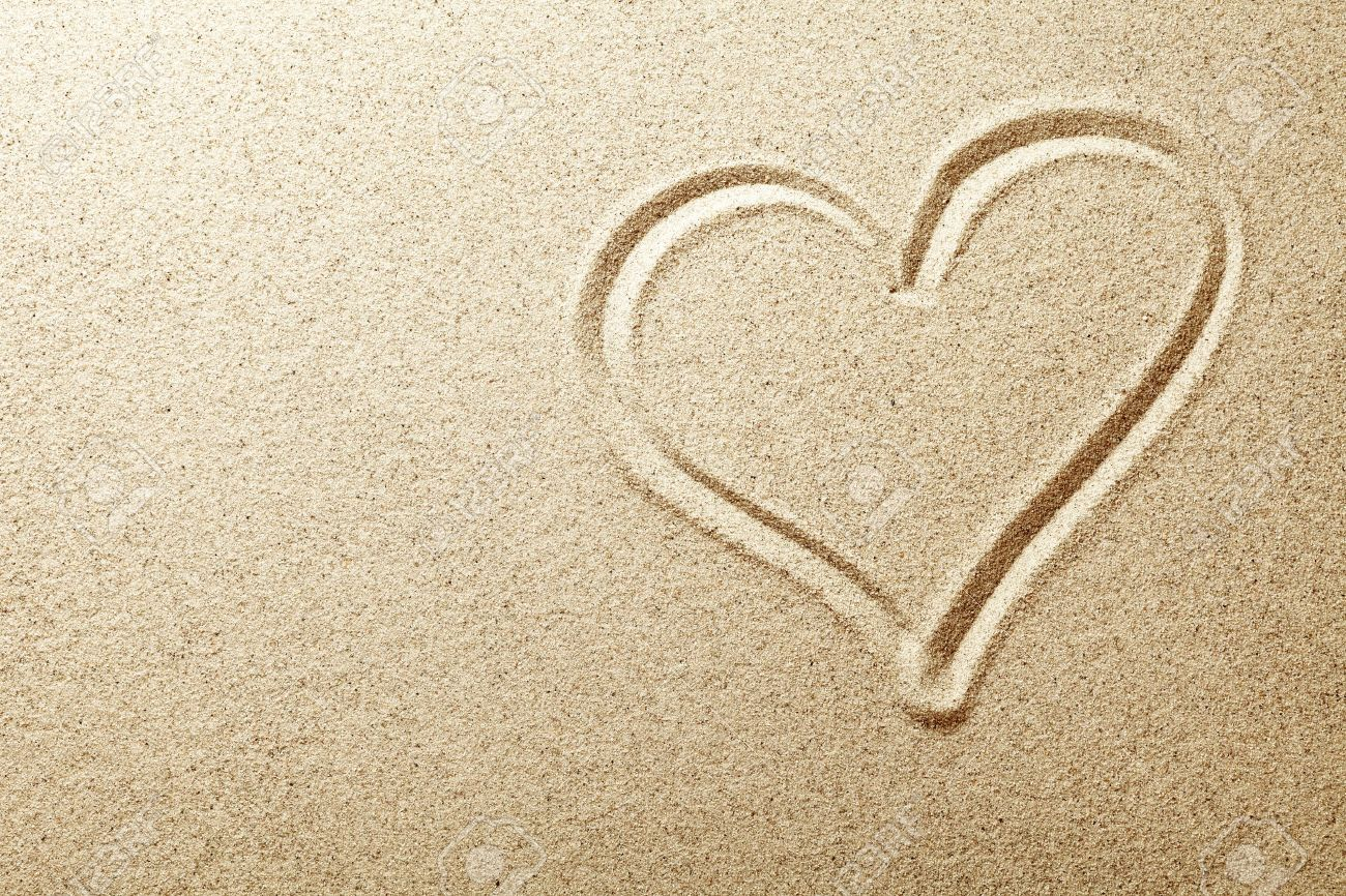 15201384-Heart-drawn-in-the-sand-Beach-b