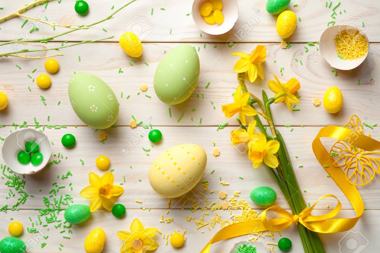 Easter Background With Easter Eggs And Spring Flowers Top View