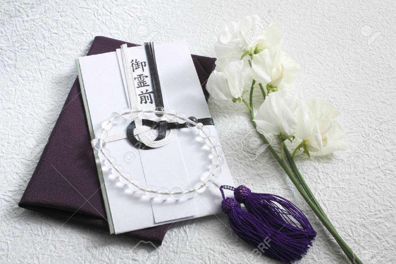 funeral gift bags and silk wrapper and prayer beads stock photo