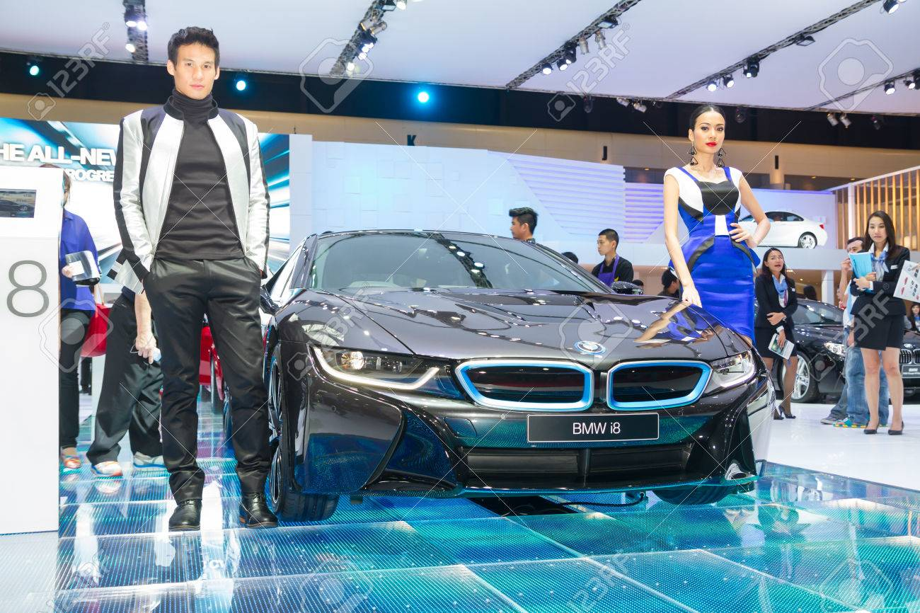 Unidentified modelling post over bmw 8i showed in 35th bangkok international motor show on march 25