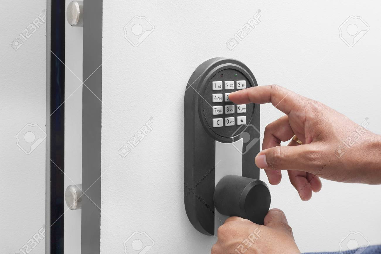 Interracial businessman hand entering security system code - 62493961