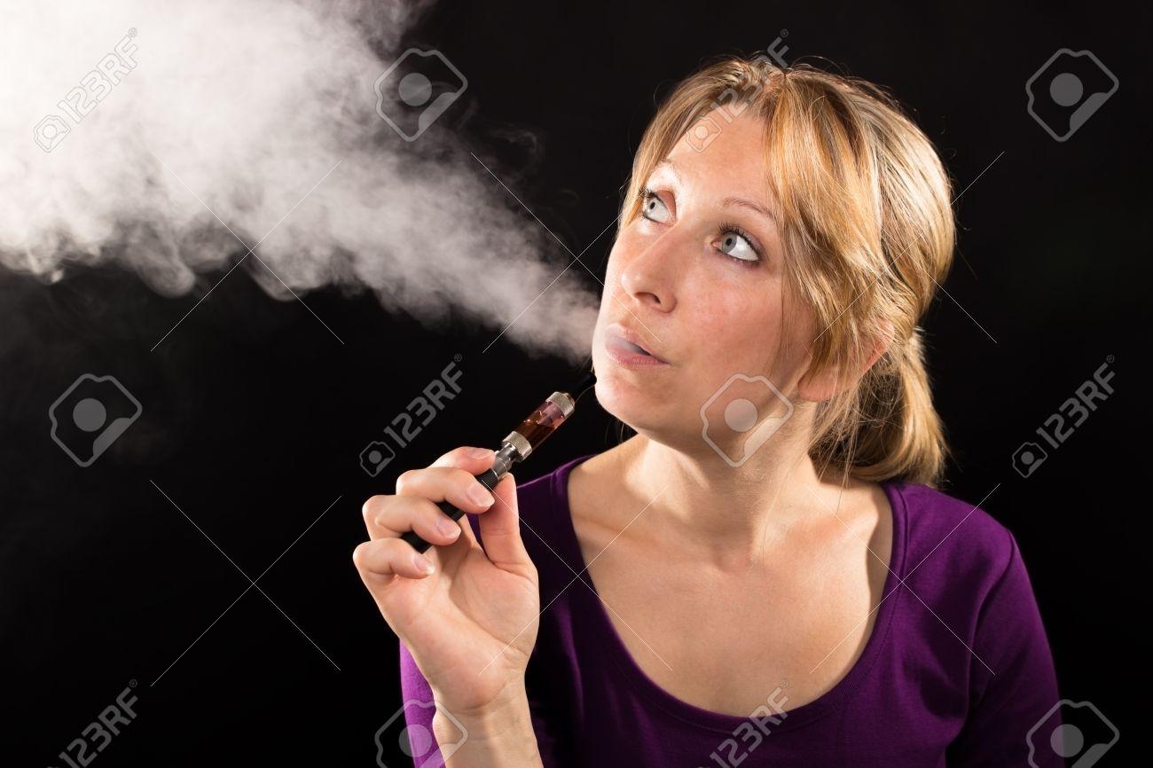 Woman enjoying e-cig - 24254851