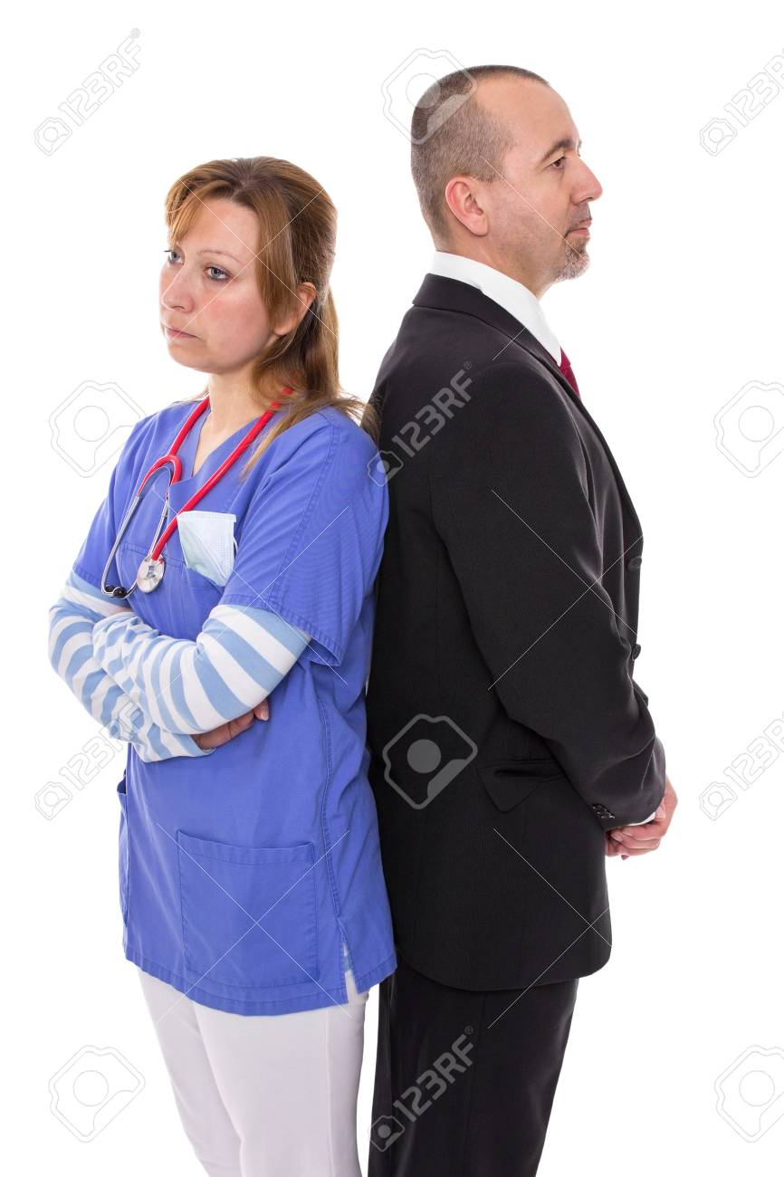 Doctor stands back to back with her boss - 27711948