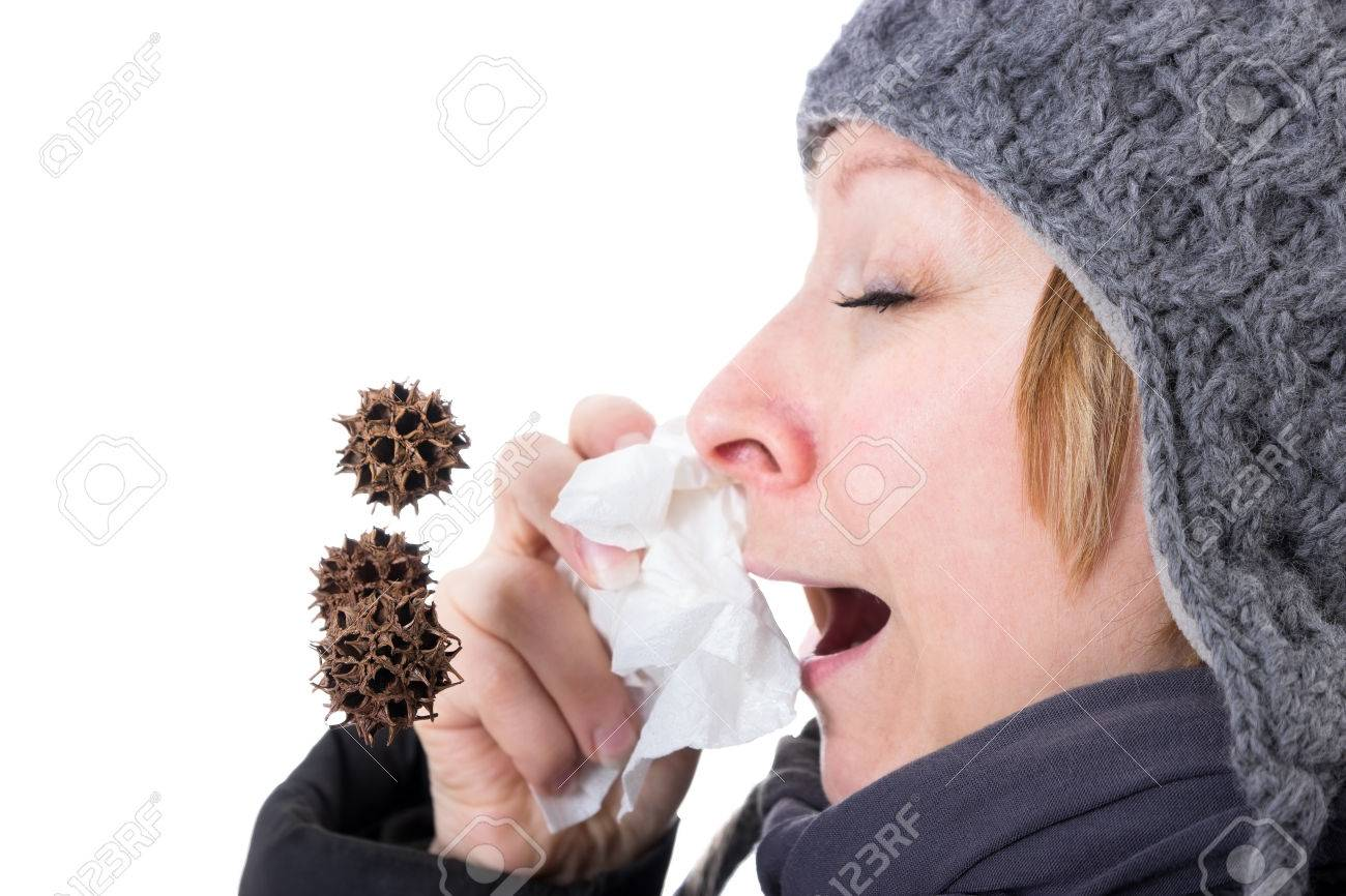 By a woman sneezing viruses and bacteria flying through the air - 28467796