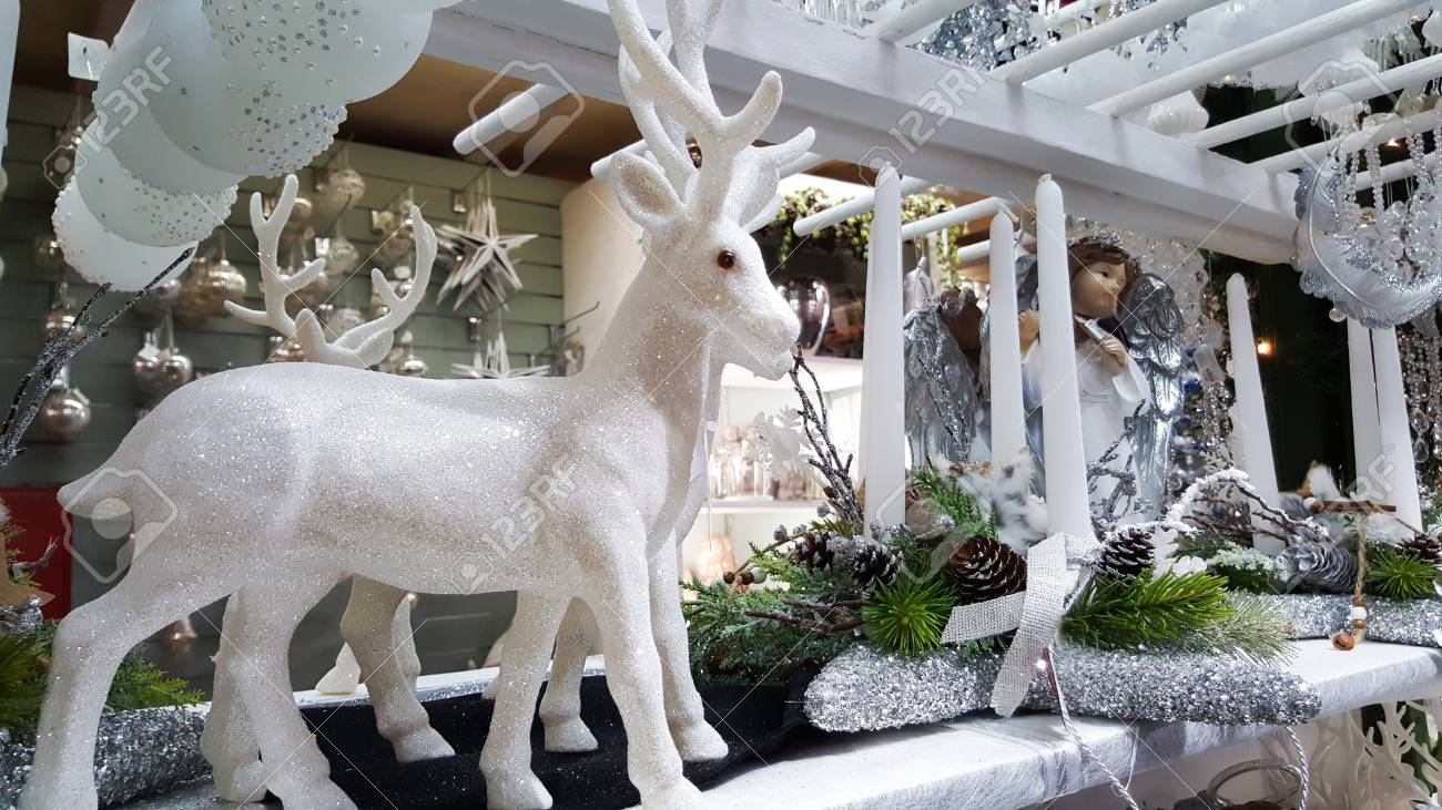 Fawn And White Christmas Decorations Displayed In A Shop