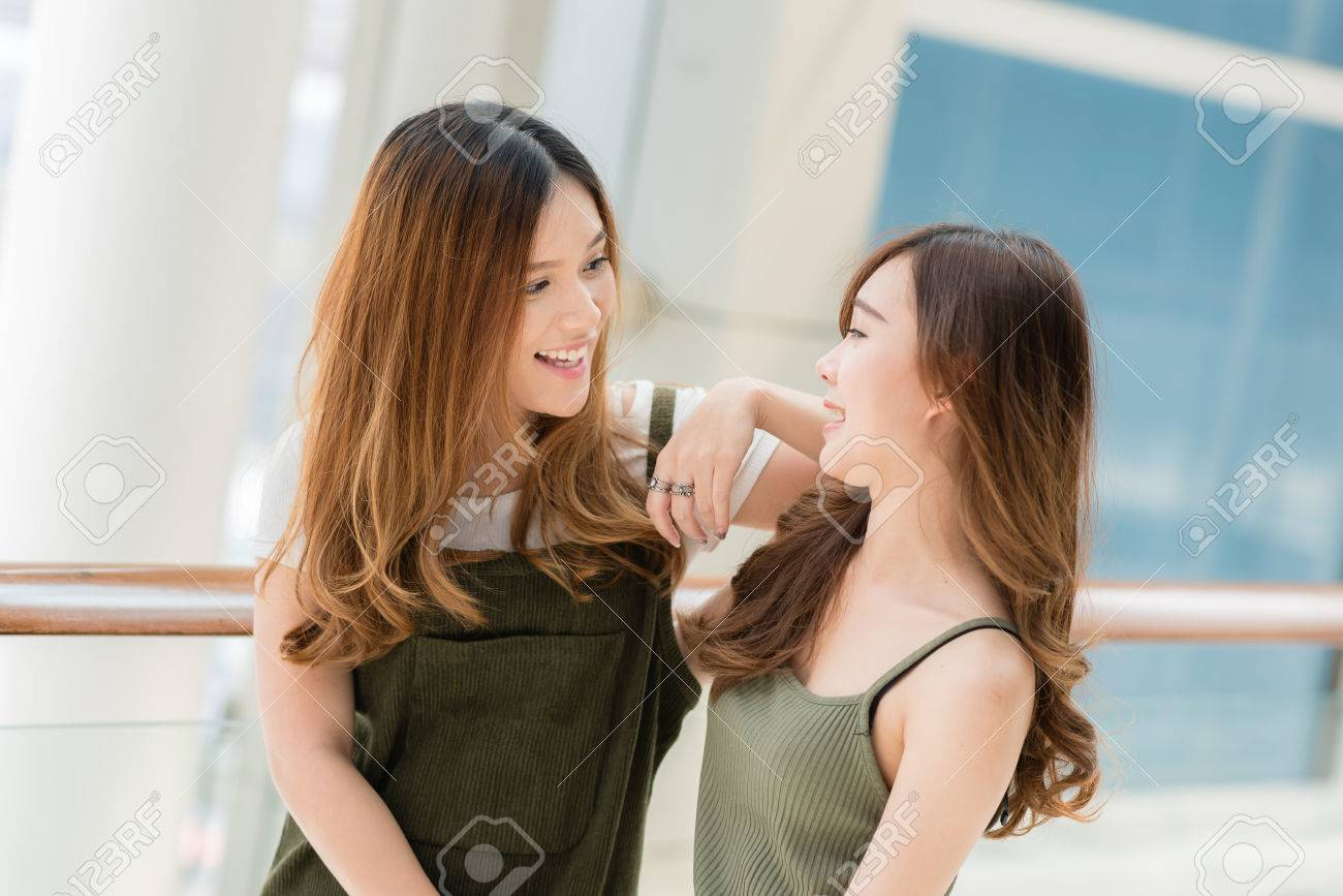 Two Beautiful Young Happy Asian Girls Best Friends Laughing Stock Photo Picture And Royalty Free Image Image 72476653