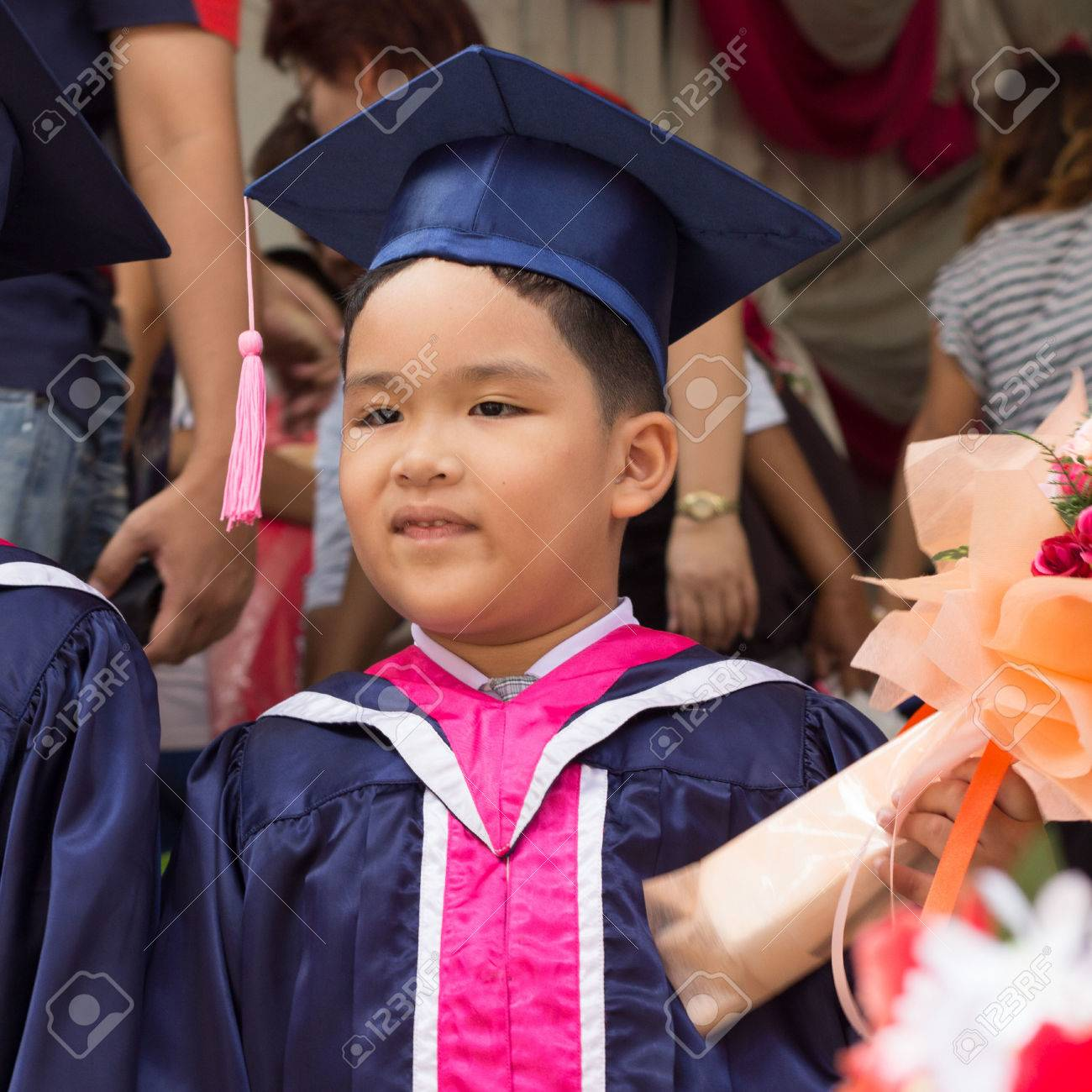 Asian Kid In Graduation Gown And Cap. Stock Photo, Picture And ...