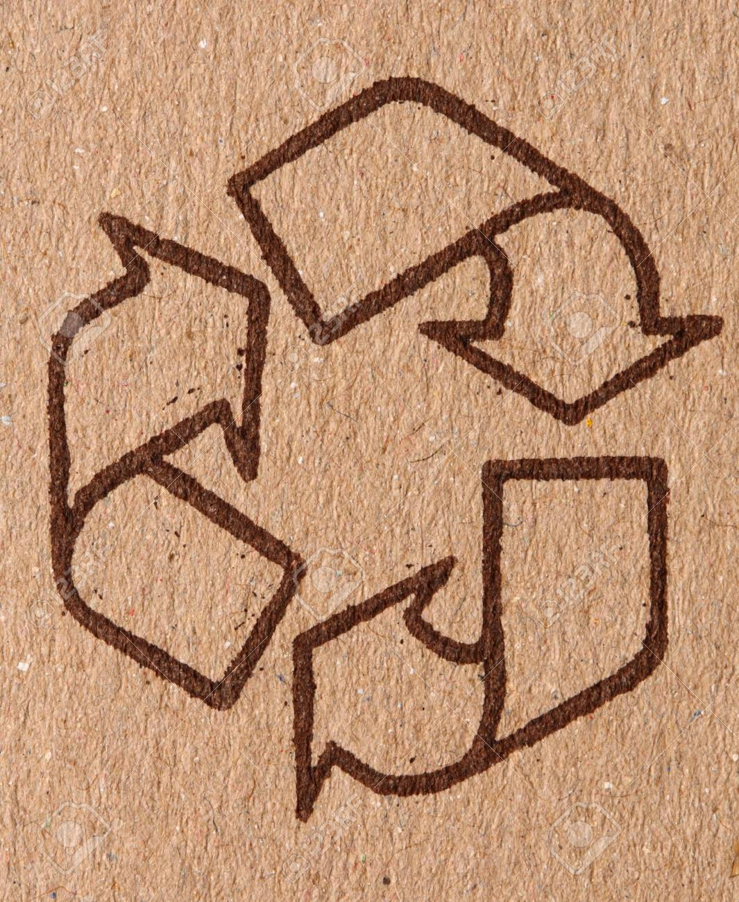 detail of classic recycle symbol on cardboard Stock Photo - 4126235