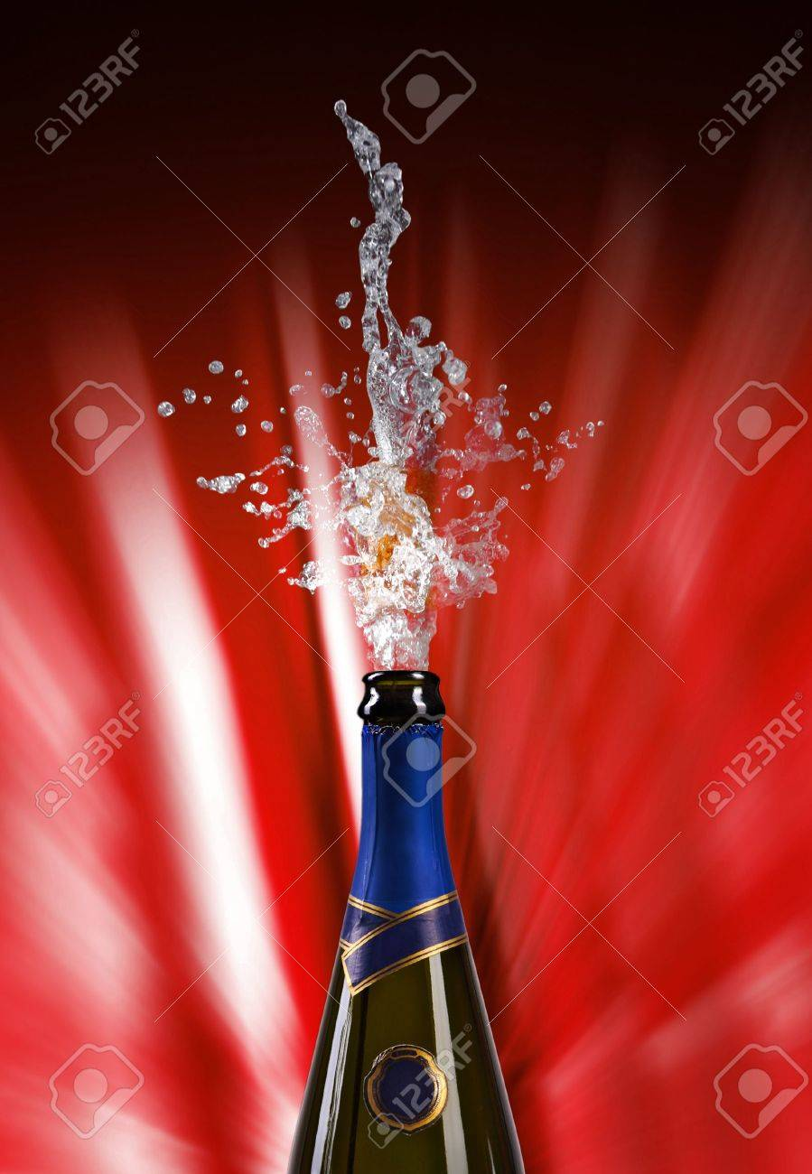 champagne bottle with shooting cork on RED background Stock Photo - 5933613
