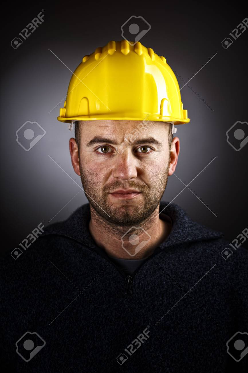 dramatic manual workwer portrait on dark background Stock Photo - 6577451