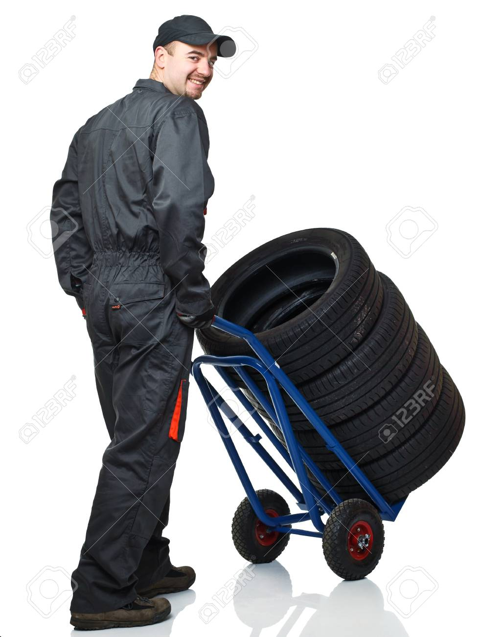 manual worker with handtruck and tires on white background Stock Photo - 8815379
