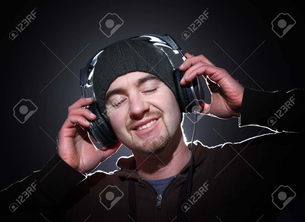 portrait of young caucasian man with cap and headphone Stock Photo - 8943911
