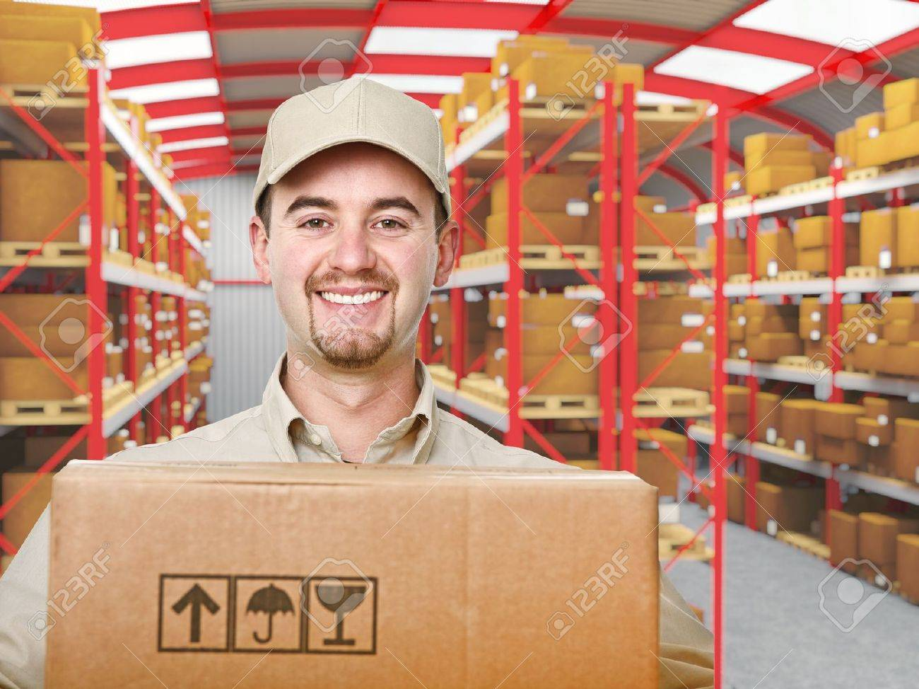 Smiling Young Delivery Man In Modern Warehouse Stock Photo   9147323