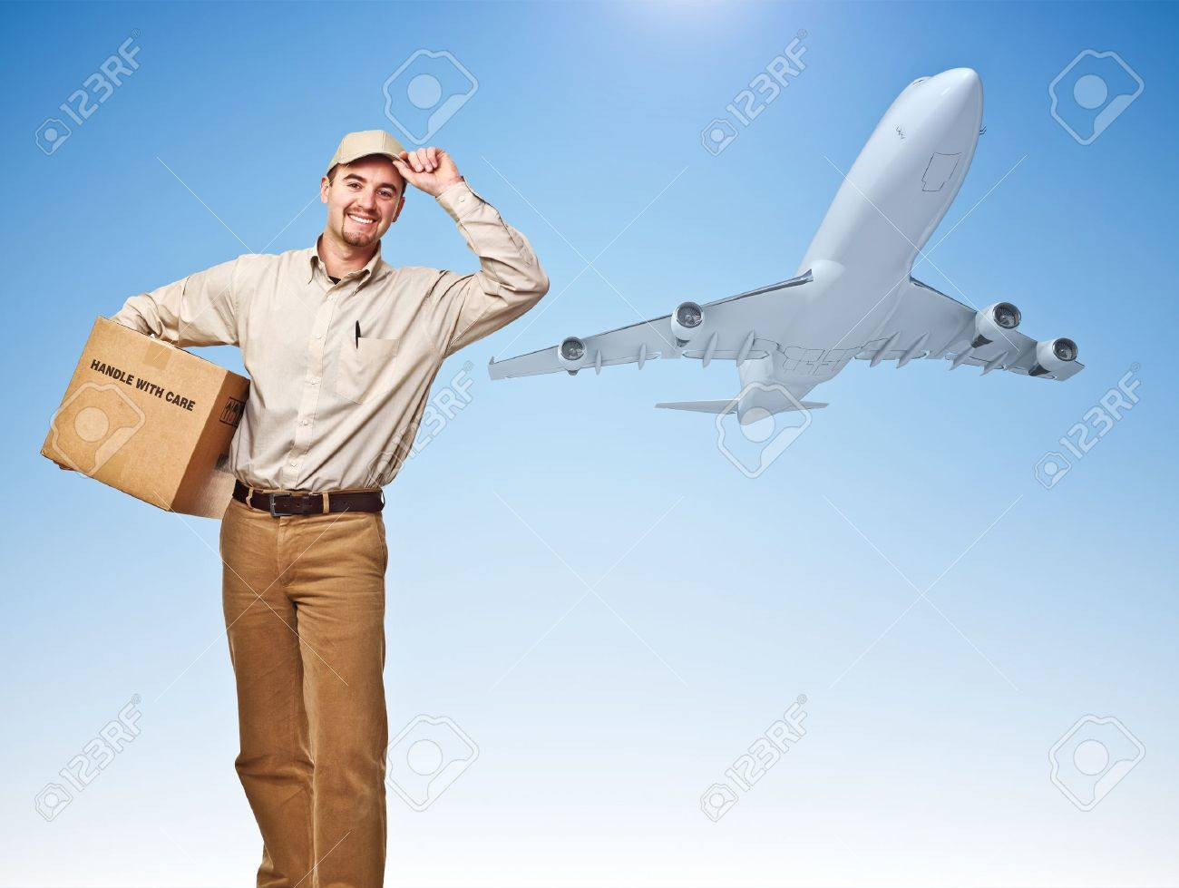 smiling delivery man and cargo airplane Stock Photo - 10659399