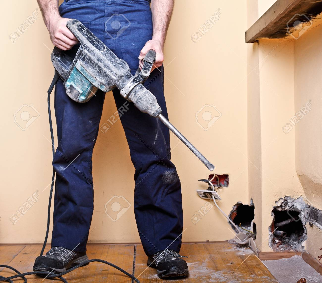 detail of manual worker with tool Stock Photo - 10749281