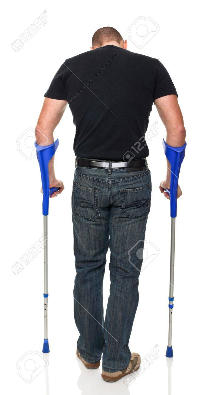 young man with crutch isolated on white Stock Photo - 11060616