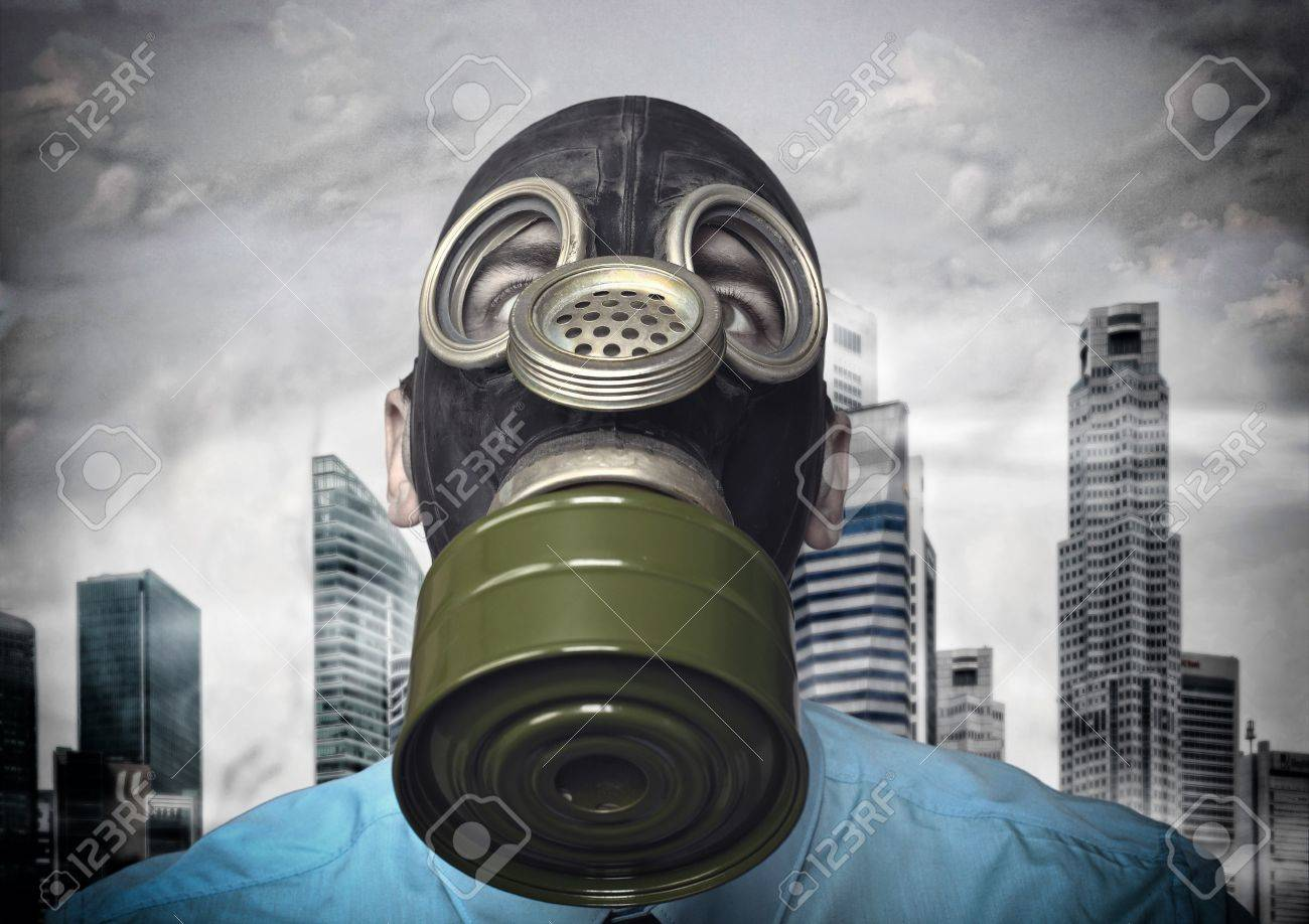 businessman with gas mask and town background Stock Photo - 13885054