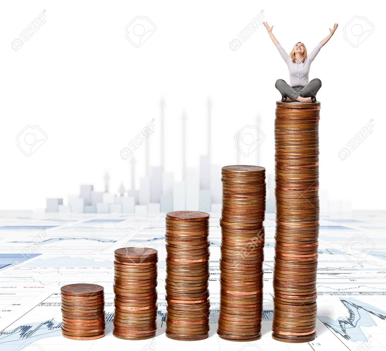 happy woman sit on euro coin piles Stock Photo - 14741711