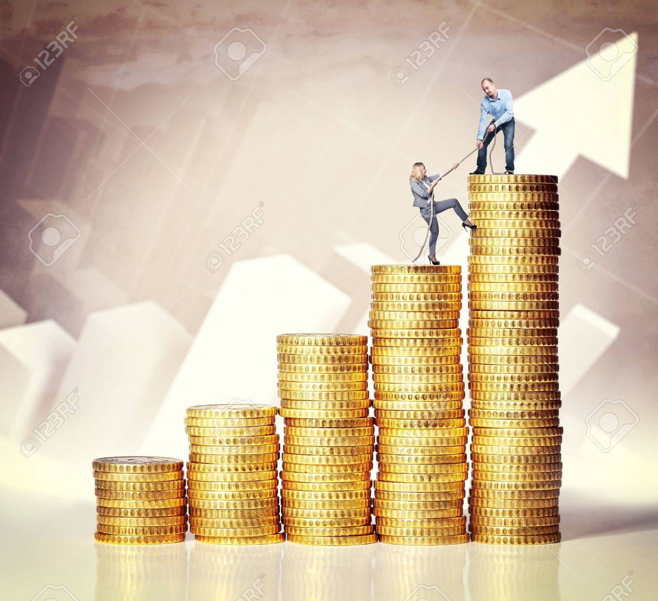 man help woman on coin piles Stock Photo - 14741712