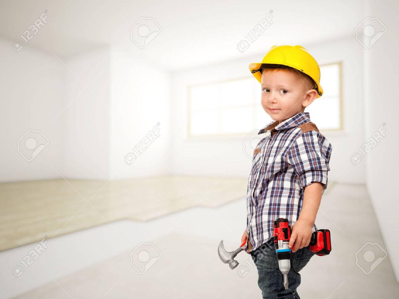 little carpenter at construction site - 46779111