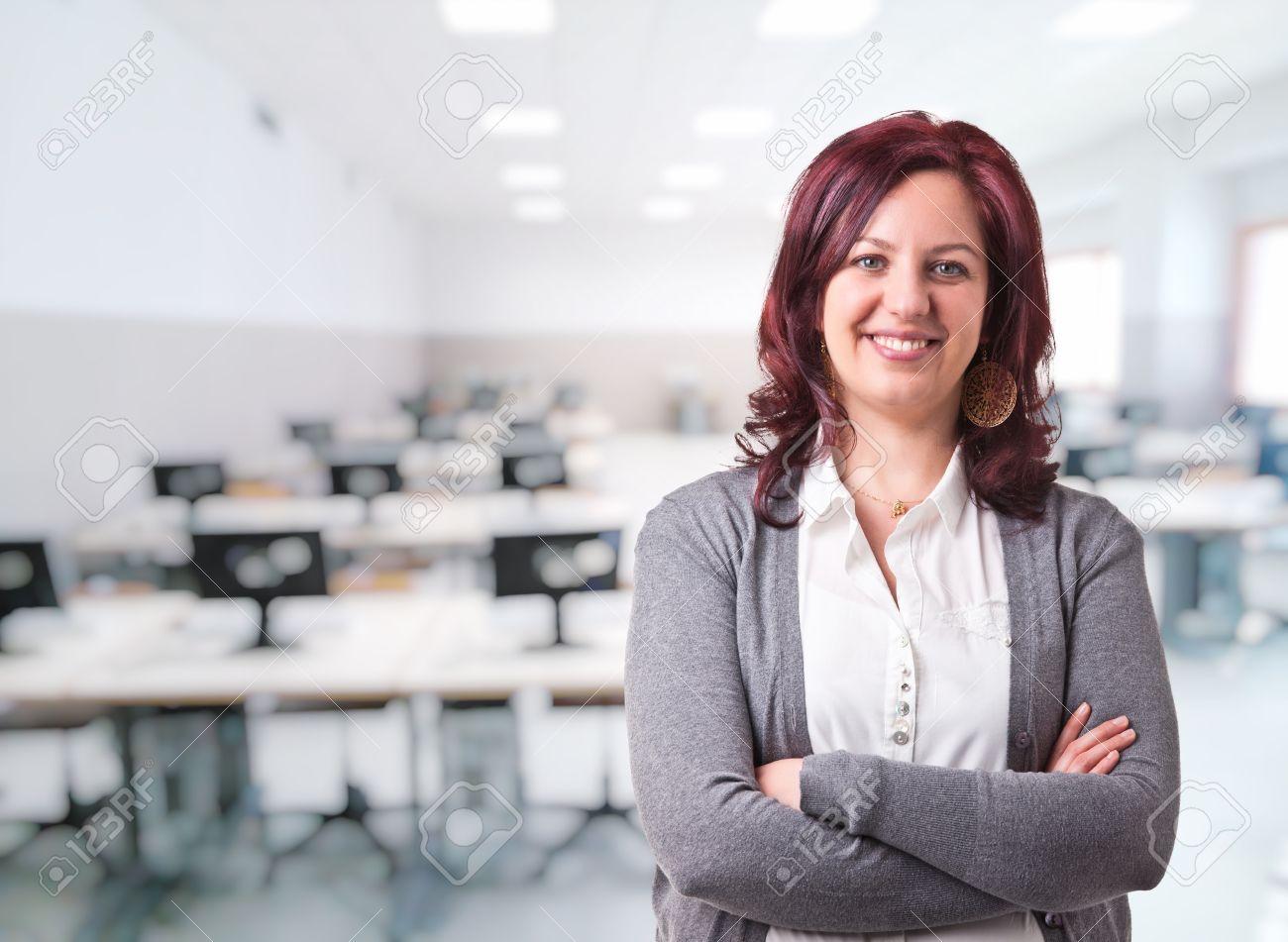 woman teacher portrait and class background - 50430776