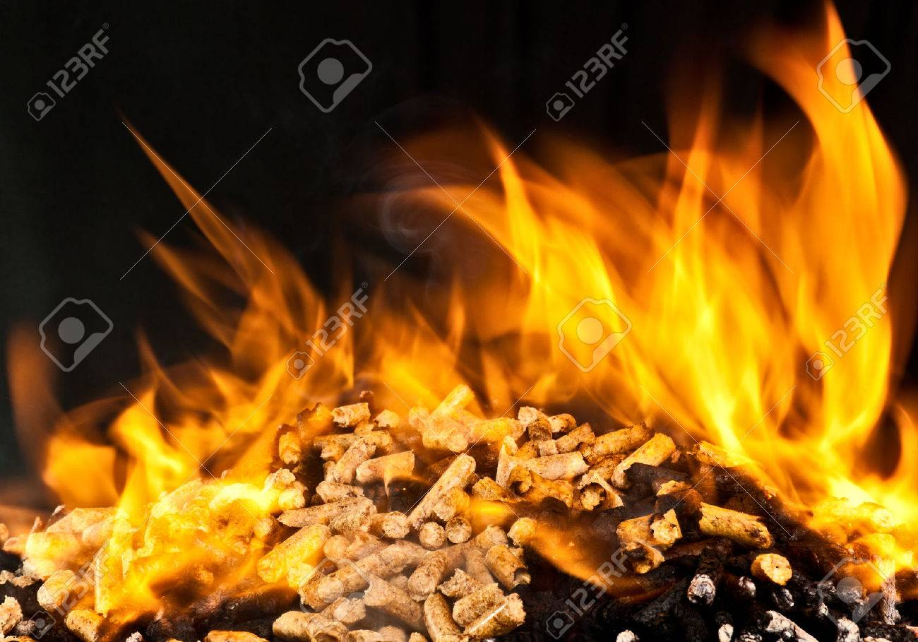 burning wood pellet with flame - 63568335