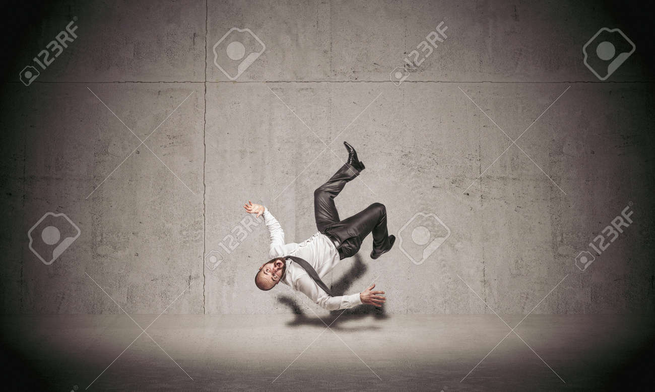 businessman falling on concrete background. - 171333284