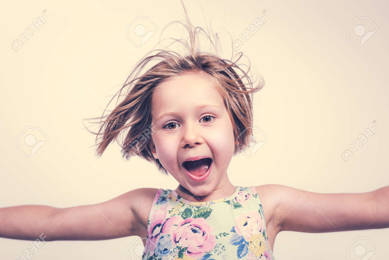 smiling and cheerful little girl with open arms. - 173236170