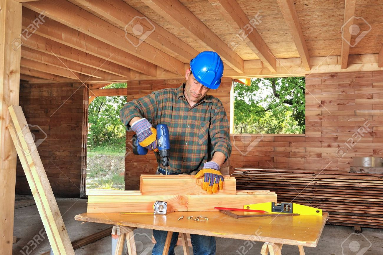 a carpenter working in his house stock photo picture and royalty