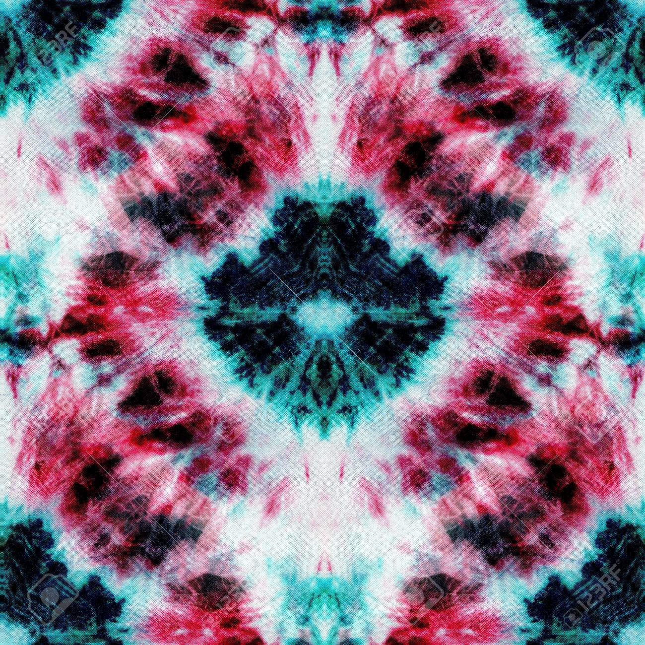 19b565a2406a Seamless tie-dye pattern of green, red and black color on white silk.