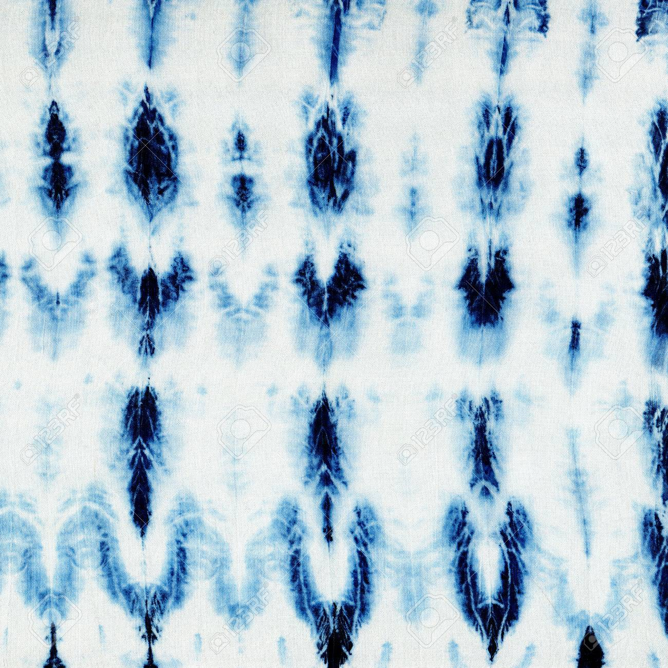 Tie-dye pattern of indigo color on white silk  Hand painting