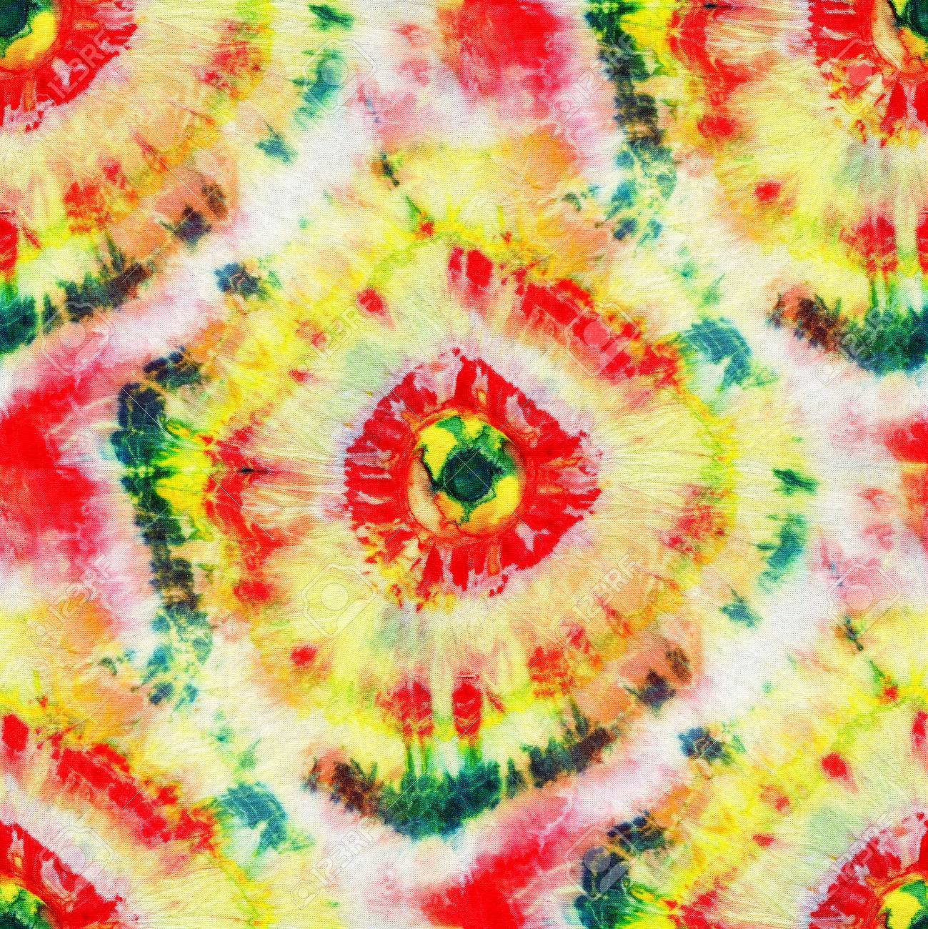 8e0865ec7243 Seamless tie-dye pattern of red, green and yellow color on white silk.