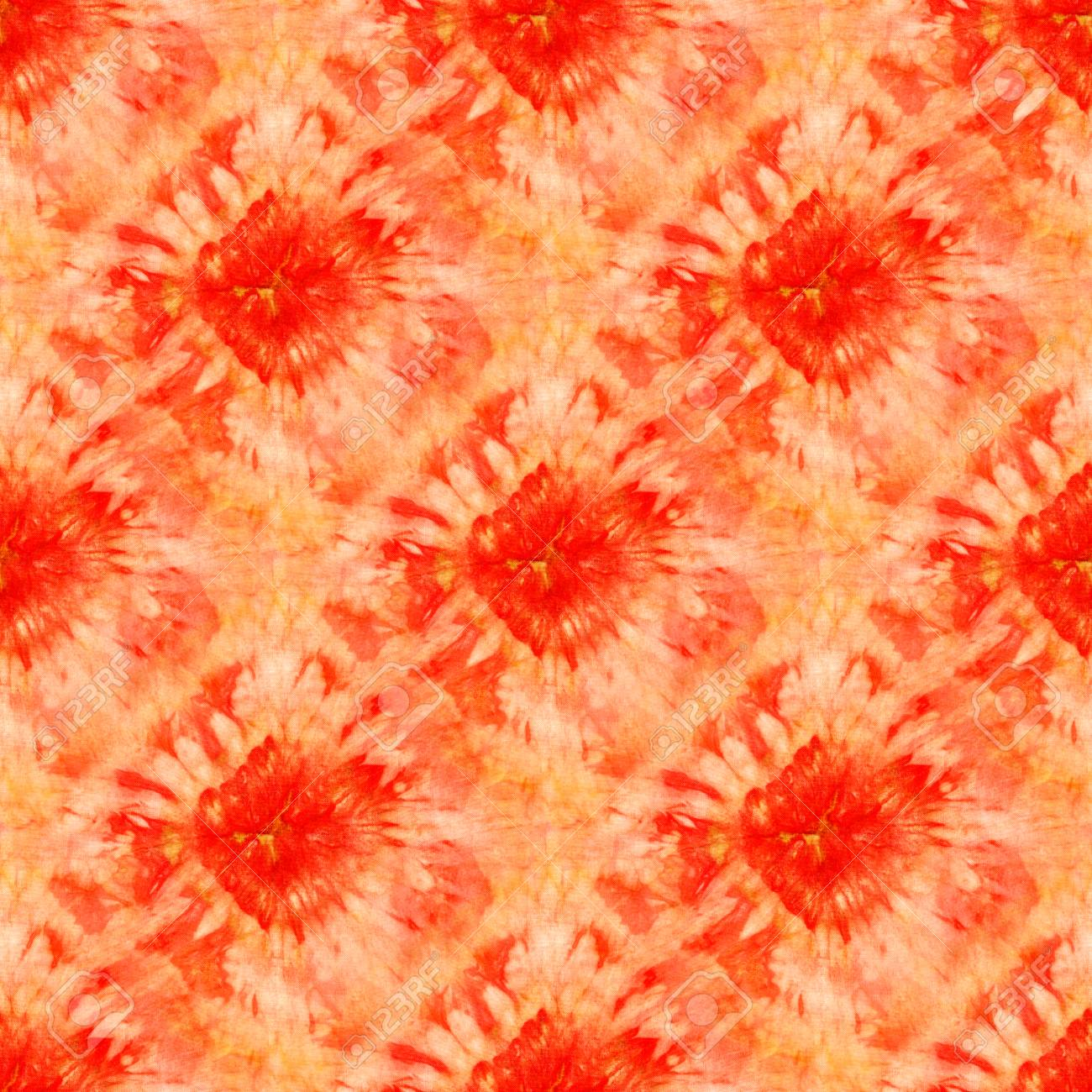 c6deeff0ea3c Seamless tie-dye pattern of red and orange color on white silk. Hand  painting