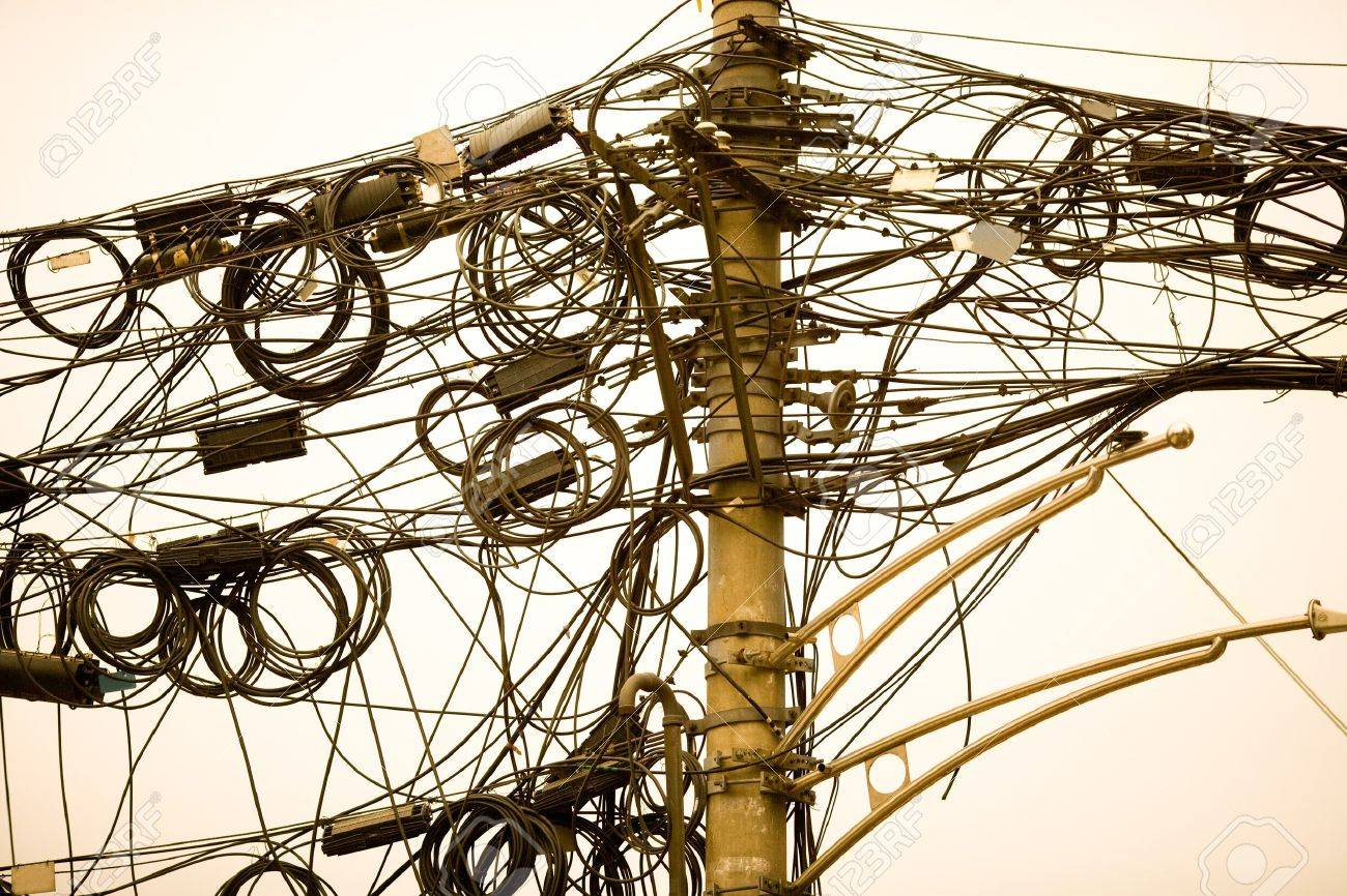 A tangle of cables and wires in Shanghai, China - 7546464