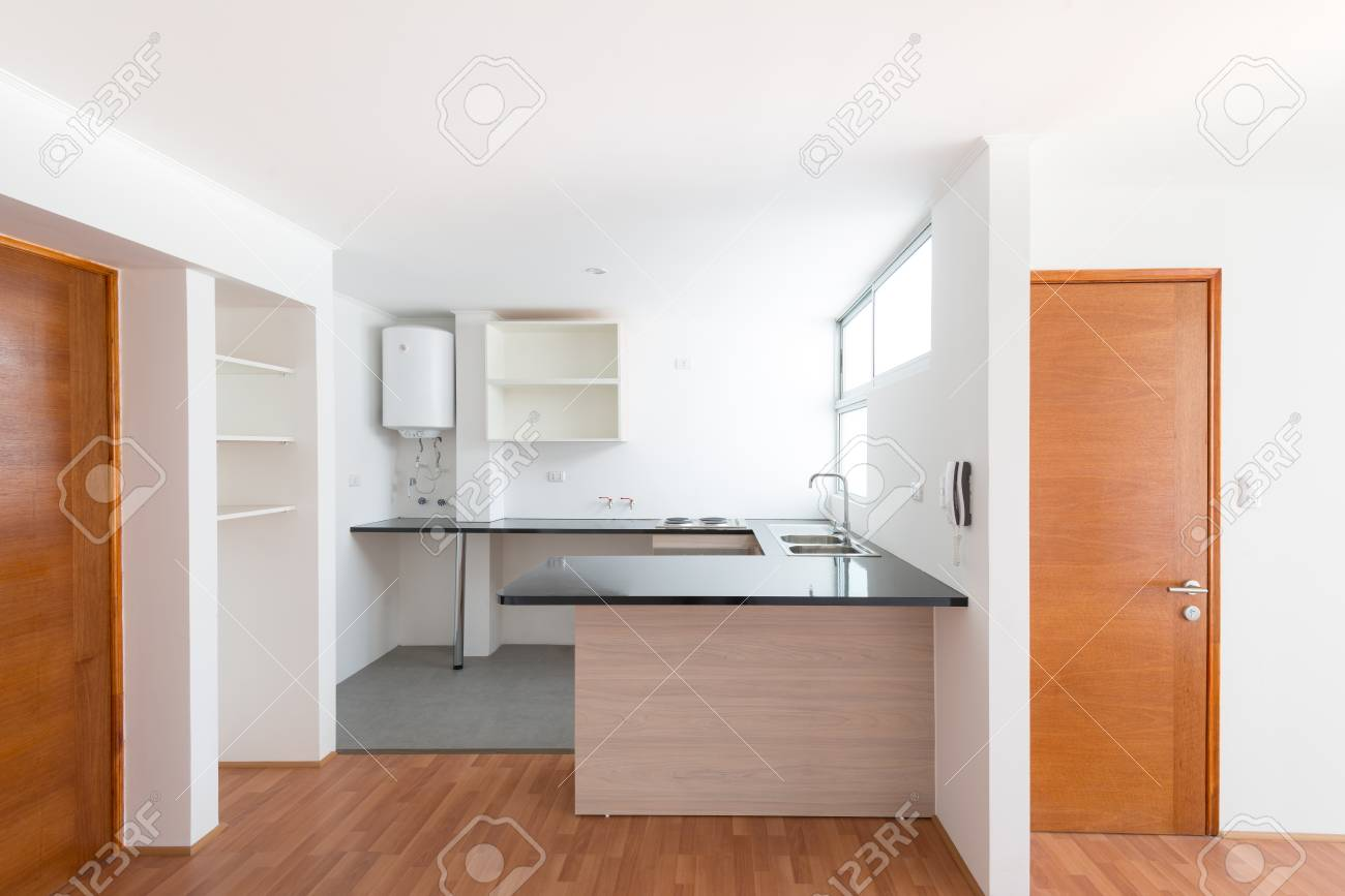 Kitchen of a small one bedroom empty apartment