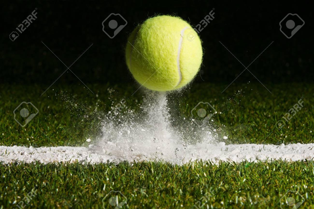 Match point with a tennis ball hitting the line - 95130027