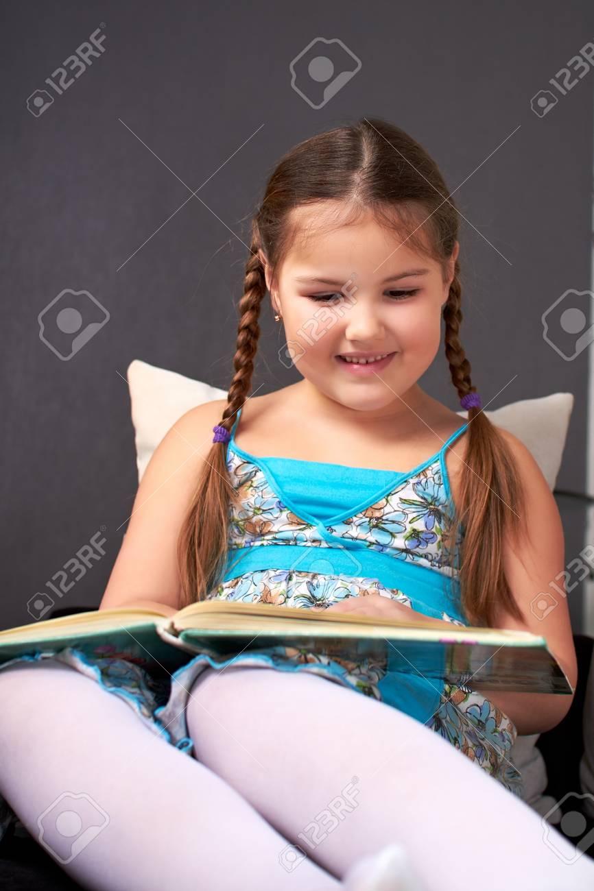 Little girl reading. Stock Photo - 8879174