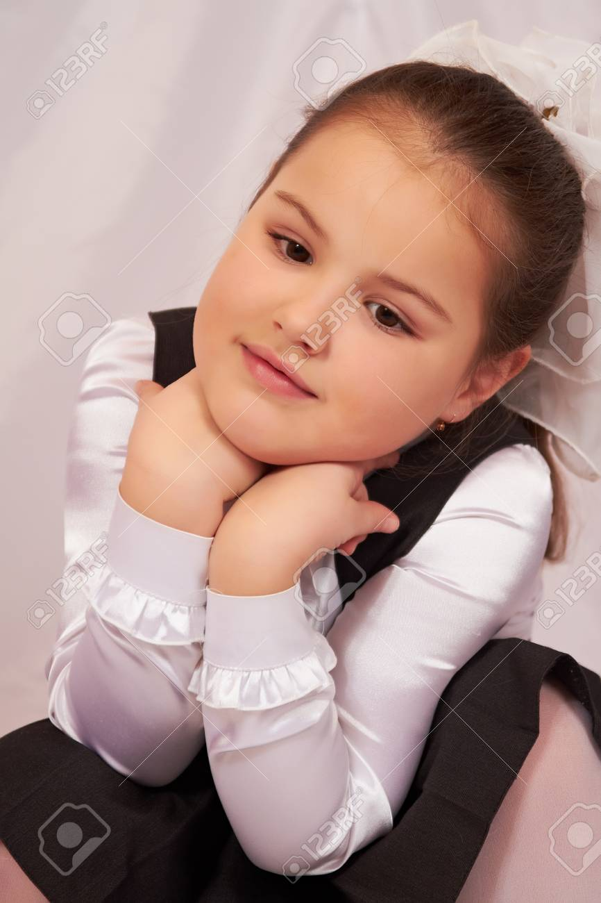 A little girl sits pensively. Stock Photo - 8879178