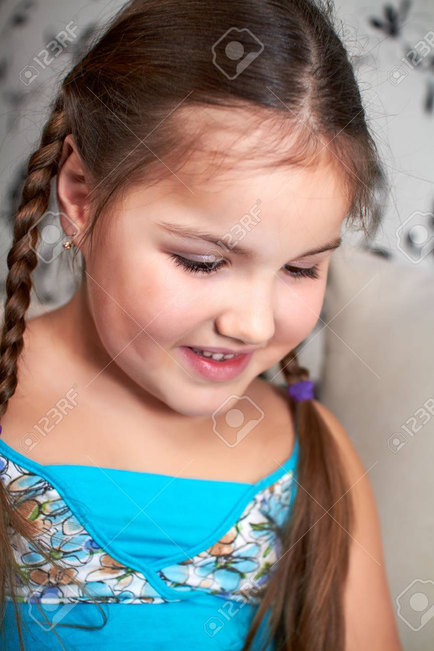 A little girl sits pensively. Stock Photo - 8970053