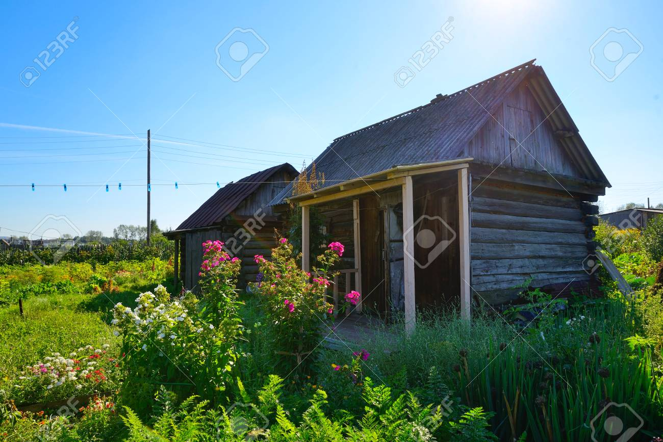 Rustic Vegetable Garden Behind The House And Old Baths Stock Photo