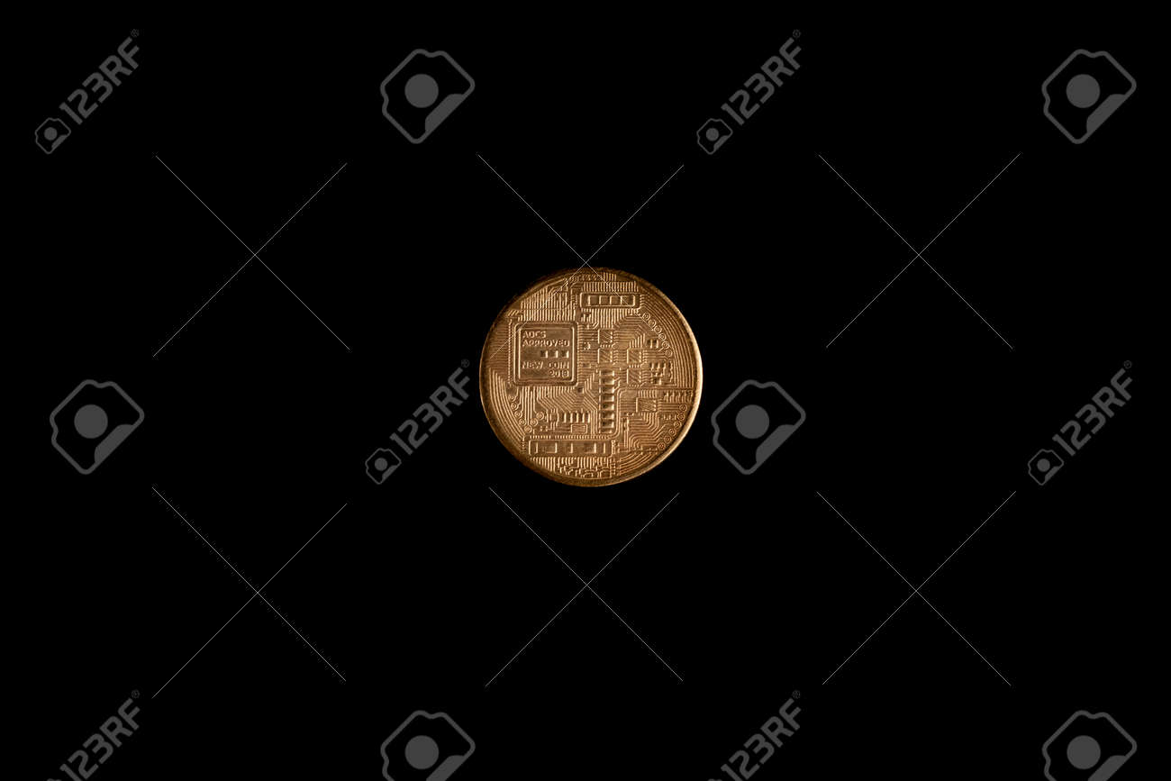 Bitcoin coin on a black background, stock photo. - 140179574
