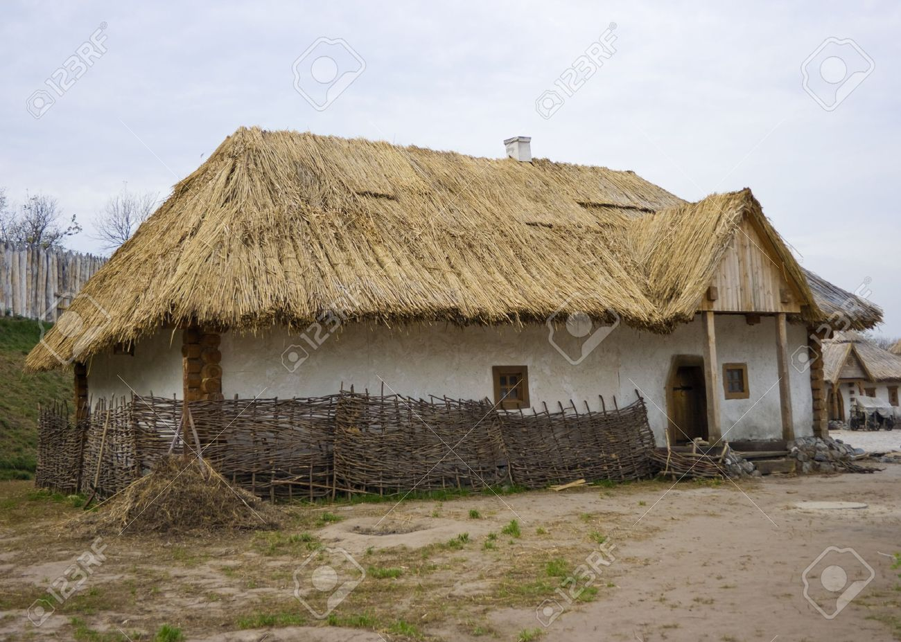 Lovely Old Traditional Ukrainian House With Thatched Roof Stock Photo   1886700